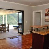 Sea House, Knysna group accommodation; The generous bar – open to the pool and outside braai patio