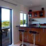 Home by the Sea; Plettenberg Bay Seaside accommodation; The bar opens up directly onto the pool deck