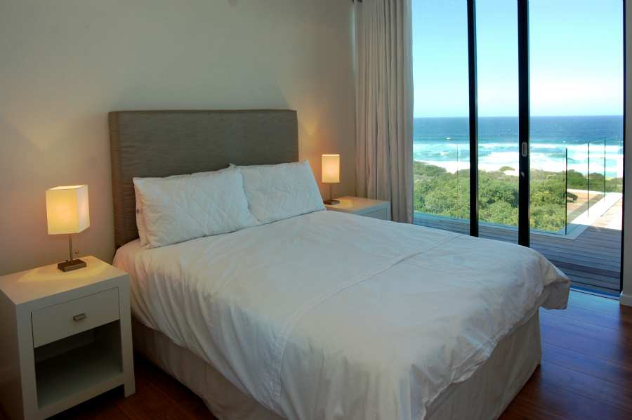 Home by the Sea, Plettenberg Bay Seaside accommodation; Bedroom 2 & 3 share a sea-side balcony that gives access to the roof viewing area