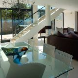 Home by the Sea, Plettenberg Bay Seaside accommodation; The dining area opens up onto the protected courtyard