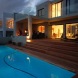 Home by the Sea, Plettenberg Bay Seaside accommodation; At night time the house is transformed – the outside fire and lounge area