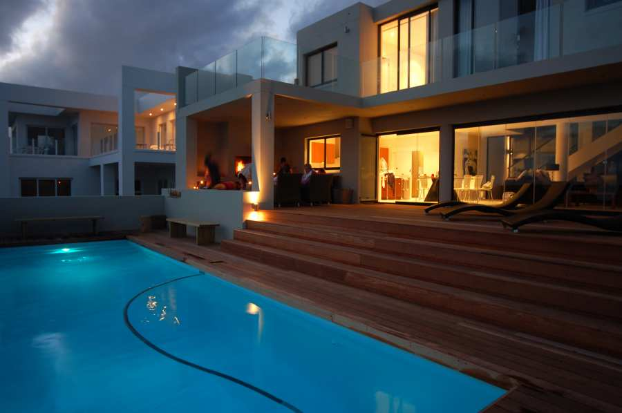 Home by the Sea, Plettenberg Bay Seaside accommodation; At night time the house is transformed - the outside fire and lounge area