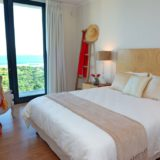 Bedroom 2 shares a balcony over the pool deck and has an en-suite shower room