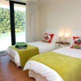Bedroom 4 with twin beds, en-suite shower room and views across the hills