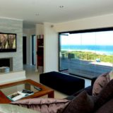 Home by the Sea, Plettenberg Bay Seaside accommodation; Slide & stack doors open the house to the beautiful surroundings