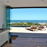 Sliding stack doors throughout you can bring the world into the house at Beachscape on Keurboomstrand, Plettenberg Bay Beach accommodation