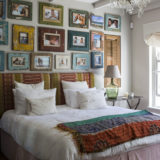 Lookout House, Luxury Accommodation, Plettenberg Bay, comfy bedroom with a wall full of interesting images