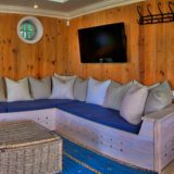 Lookout House, Comfy couches in pool side bar room