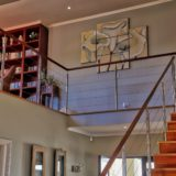 Sea House, Group Accommodation, Stairway to upper level and Library Corner