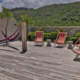 Beachscape, Keurboomstrand, Plettenberg Bay -Protected deck with Hammocks and Deck Chairs