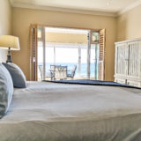 Beach-Cove-Villa-Seaview-Accommodation-Plett-Bedroom-4-Main-Bedroom-leading-out-to-terrace