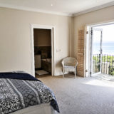 Beach-Cove-Villa-Seaview-accommodation-Plett-Bedroom-3-has-a-small-private-balcony