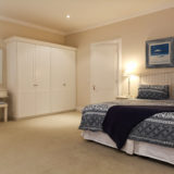 Beach-Cove-Villa-Seaview-accommodation-Plett-Bedroom-3-with-dressing-table-and-ample-cupboard-space