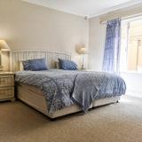Beach-Cove-Villa-seaview-accommodation-Plett-Bedroom-1-downstairs