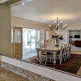 Beach-Cove-Villa-seaview-accommodation-Plett-Dining-Room-leading-to-outdoors-and-downstairs-lounge